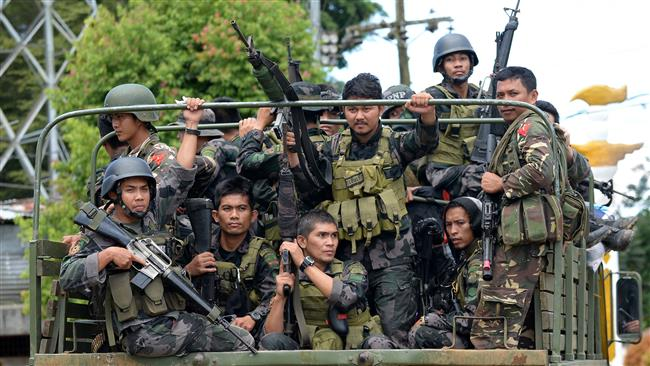 Gunmen raid school in southern Philippines, withdraw later