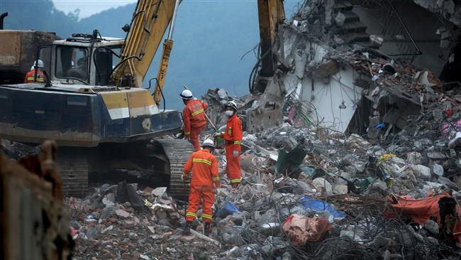 Around 100 people buried in China landslide: Officials