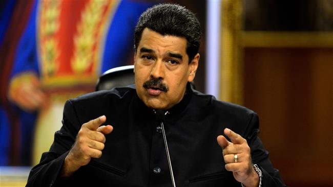 Maduro vows to fend off 'coup' after attacks