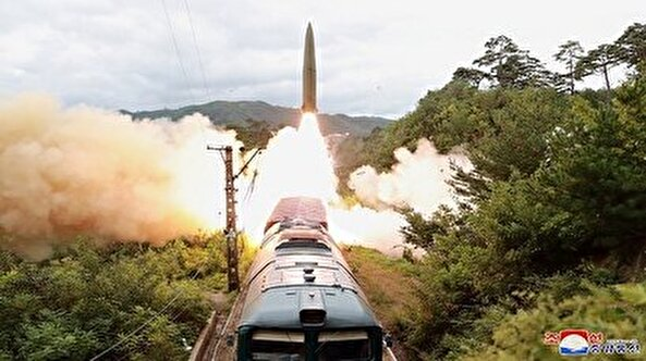 N.Korea says it tested new railway-borne missile system to strike 'threatening forces'