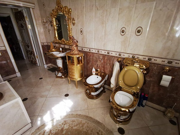 Russian traffic officer with golden toilet is arrested after police uncover massive bribery scheme